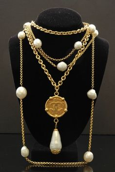 VINTAGE CHANEL CC MEDALLION WITH PEARL PENDANT  Designer: CHANEL    Gorgeous vintage Chanel necklace with cc medallion and pearl drop. This is a staple for any fashionista's wardrobe! Wear it alone or layer with other Chanel jewelry. (Long pearl sautoir sold separately). Circa 1975