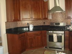backsplash pictures with oak cabinets and uba tuba granite | re