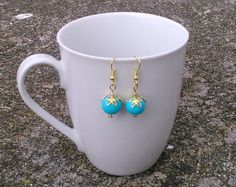 Toremore Crafts - turquoise glass bead earrings with golden foliage bead caps