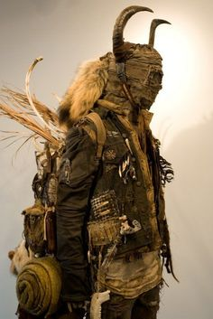 Very unique piece, makes me think of a desert nomad/shaman. Could even be a traveling medicine man.: