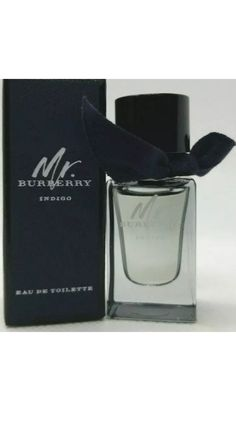 Mr. Burberry Indigo Eau De Toilette Dabber Cologne Mini .16 oz mini  Mr. Burberry Eau de Toilet is an intense interpretation of the original Mr. Burberry, the fragrance captures the essence and anticipation of London at nighttime. A warm, sensual and woody scent with fresh and aromatic top notes of tarragon and comforting, spicy cinnamon, layered delicately on rich patchouli with a base of amber and smokey vetiver. The bottle honours the black Heritage Trench Coat and its signature design… Burberry Men, Signature Design, Woody, Spray Bottle, Cologne, Trench, Lotion, Cinnamon, Indigo