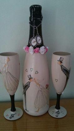 Botella de champan con copas para boda