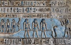 "[EGYPT 29582]<br /> 'Pulling the sun bark at Dendera.'<br /> <br /> 	Three gods are pulling the sun bark across the sky on the astronomical ceiling in the outer hypostyle hall of the Hathor Temple at Dendera. The ceiling consists of seven separate strips but here we are looking at a detail of the lower register of the SECOND STRIP WEST from centre.<br /> A caption above the three men mentions that ""they are the stars who accompany the sun in the northern sky."" That fits with the main…"