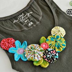 @Melissa Hale -- do you think this shirt looks ok with different color fabric flowers? I remember we had talked about this once....