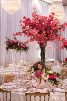 It was love at first sight when we saw these jaw-dropping pink wedding centerpieces! | Photography by: 5ive15ifteen Photo Company | WedLuxe Magazine | #WedLuxe #Wedding #luxury #weddinginspiration #luxurywedding #rosewedding #pinkflowers #pinkwedding #tallcenterpiece