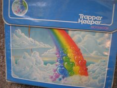 Boy did I love my Trapper Keeper!  Mine had the image of a rainbow flowing majestically down onto a white swan.  80's baby!
