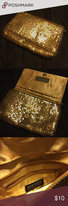 EUC Gold Sequin Clutch New York & Company Gold clutch. Gently used- smoke free home. Features magnetic closure, small mirror & smaller zip compartment. Also has zip closure to keep everything inside. Check out my other great accessories & bundle to save! New York & Company Bags Clutches & Wristlets