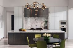 I like the dark wood cabinets with white marble counter and backsplash. I also like the feel of the light wood floors. I don't love the white cabinetry...maybe would prefer something contemporary with glass instead...