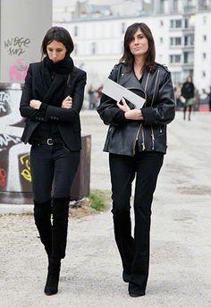 Geraldine Saglio wears black skinny jeans, black boots, black belt, black blazer, and black scarf.