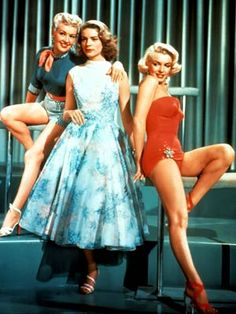 How to Marry A Millionaire...Lauren Bacall, Marilyn Monroe and Bette Grable. Three girls pool their resources to snag rich husbands...take notes!