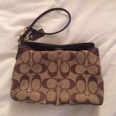 Coach wristlet with convertible strap Authentic Coach wristlet in a classic pattern with convertible strap! Perfect for going out. Fits your phone, small wallet, your keys and a lipstick! Coach Bags Clutches & Wristlets