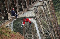 Guatemalan Firefighter Hector Chacon, dressed as Santa Claus, rappels down from the Belize bridge to give toys to children living in the area under the bridge, Guatemala City: http://www.thestar.com/news/world/article/1306635--photos-this-is-how-santa-delivers-presents-in-guatemala