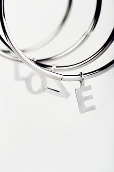 Simple #bangle #bracelet, made of polished 925 #silver, with one silver #charming #initial by #maschiogioielli #milano #contemporaryjewels #setofbracelets #letters #customizated