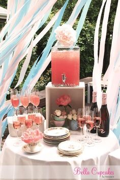 Since I really don't drink, I would probably use a light pink lemonade or sparkling water with a touch of cranberry juice.  Serve all in champagne glasses.  Love how beautiful the tablescape is.