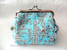 Frame purse in a turquoise 'Paris' print. Turquoise purse. Mini make-up bag. £11.00
