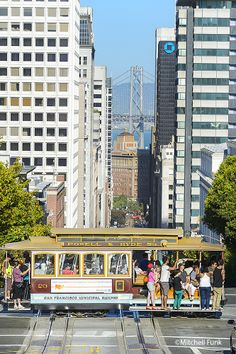 Cable Car Crossing California Street With Bay Bridge InThe Background, San Francisco www.mitchellfunk.com