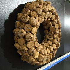 Have you ever seen a cork wreath made totally of champagne corks? Here is a gutsy presentation. Meticulously placing alternating champagne cork tops and alternating bottoms. Approximately 130 cut champagne corks makes a statement on this 12 wreath. Other sizes available (CC12-A) Also available in 14 using approximately 170 corks in 6 rows. $75.00 (CC14-A)