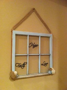 DIY old window frame with rub on lettering and burlap flowers.