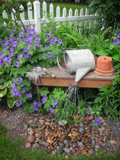 Watering can fountain....so cute.