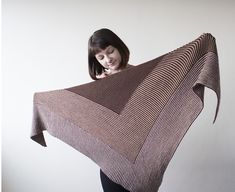 This is a printed pattern that requires shipping. Japanese for stripe, Shima Shima, is an expansive triangular shawl knit in modular sections of directional stripes. Use Woolfolk Tynd's tonal colors f Knitted Poncho, Knitted Shawls, Crochet Scarves, Knitting Designs, Knitting Projects, Knitting Patterns, Knitting Ideas, Knit Or Crochet, Crochet Shawl