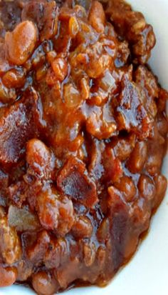 Been there, tried this.  Delicious! Baked Beans with Ground Beef and Bacon - A Trisha Yearwood Recipe