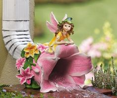 These charming garden gnomes hide the base of a downspout and turn it into an artistic landscaping feature. Description from… Gutter Downspout Extension, Gutter Drainage, Lawn And Garden, Garden Art, Garden Ideas, Gutter Accessories, Decorative Downspouts, Garden Spells, Collections Etc