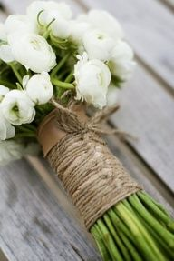 wedding flowers that a simple to match the dress but with a roped off flair for a great look.