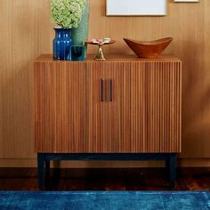 West Elm Reed Bar Collection (low), walnut, 74-8013216 http://www.westelm.com/products/reede-bar-cabinet-low-h1625/