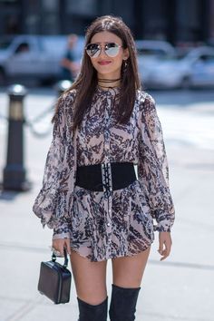 Who: Victoria Justice Affordable Fashion Find:H&M Studio dress, $50, hm.com. Why We Love It: The actress's airyboho dress looks even more luxe with all the right accessories: a corset-style belt, over-the-knee boots and mini bag.
