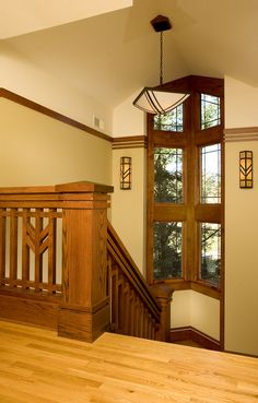 Prairie style staircase with chunky newel post. Prairie/Mission Style - Frank Loyd Wright. This is his wheat motif.