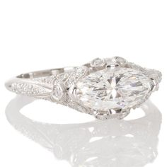 A platinum engagement ring by Sebastian Barier featuring a 1.16ct marquise cut diamond. View our collection of antique, Art Deco, and modern jewellery at www.rutherford.com.au