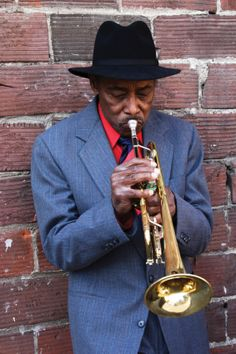 New Orleans musician playing the saxophone! Photo by Rick Lord.