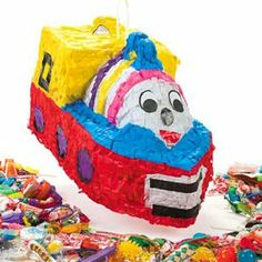 "Choo-Choo Train Pinata by Fun Express. $19.99. Measures: 16 1/2"" x 11"". Pinata Stick, Toys, and Candy Not Included. 1 Pinata. Hanger Included. Paper. What finishes off a train party better than a Choo-Choo Train Pinata? This fun Pinata is a great treat for children of all ages at your child's train themed party."
