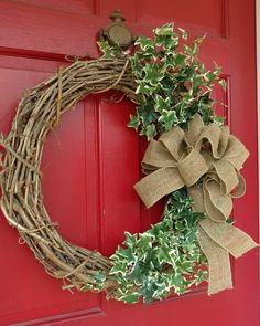 Welcome spring! Made this wreath over coffee this morning. The red door is cute, but challenging color-wise! #springdecor garden #gardendecor