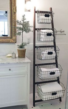 Storage Solutions All Around the House • Great Ideas and Tutorials! -- Diy'able? -- Would love this! Wood Ladder, Ladder Bookcase, Ladder Decor, Wire Baskets, Bathroom Organization, Attic, Lofts, Loft, Wooden Ladder