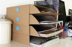 With a little bit of Makedo and some old cardboard, you can make yourself a desk tidy. Utterly brilliant.