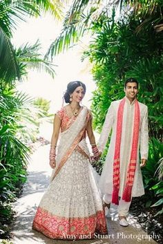 This Indian bride and groom celebrate their wedding day with a beautiful portrait session! her dress except green/blue accents rather than pink