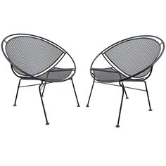View this item and discover similar for sale at - or black patio chairs designed by Maurizio Tempestini for Salterini. These are the desirable clamshell, orange slice, or hoop chairs. The pair