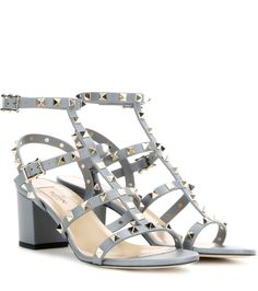 Valentino - Rockstud leather sandals - The Valentino 'Rockstud' family welcomes another new member. These sandals are crafted from a divine powder blue leather and finished, of course, with those signature studs that make them such an iconic addition to your wardrobe. We love the modest block heel - very chic and a more comfortable alternative to the stiletto. seen @ www.mytheresa.com