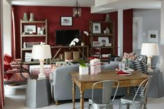 Grey and red makes an interesting colour combination in this living space by Sarah Richardson.
