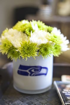 Seattle Seahawks party decorations and food from my dirty aprons blog  #gohawks  Seahawks flower arrangement with blue vinyl sticker made with the Silhouette Cameo @silhouettepins