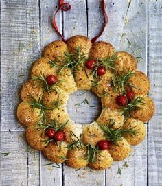 Cheese bread sharing wreath. A festive showstopper made of the softest, most tempting bread. This recipe is best made on the day and warmed through before serving.