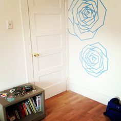 Blue roses made of tape on the far wall -