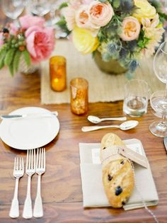 A pretty table, and I love the idea of placing a baguette at each setting for the guests to snack on while they wait for the first coarse to arrive.