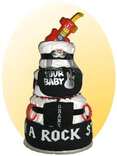 Rock out in style with this Rock-n-Roll themed baby cake. Your new star will be jammin with a matching rock star blanket, bib and pacifier. Top this cake off with V-Techs musical guitar and you have yourself a wrap. Diaper Parties, Baby Shower Parties, Baby Shower Themes, Baby Shower Gifts, Baby Showers, Shower Ideas, Cute Babies, Baby Kids, V Tech