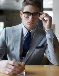 grey suit. blue tie. glasses. perfection