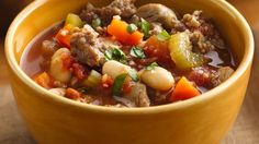 Unravel the flavors of Italy with a wholesome sausage and bean stew made using Progresso® products.