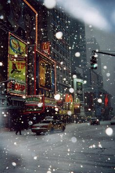 Times Square in the snow. | by Benjamin Edwards