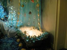 They fill the tub and sink with glass Christmas balls, with white lights underneath them to make it look like a magical bath of bubbles. Glass fish ornaments and clear baubles hang from a blue shower curtain. Little Mermaid Bathroom, Mermaid Bathroom Decor, Mermaid Bedroom, Bathroom Ideas, Before Christmas, Christmas Home, Glass Christmas Balls, Girl Bathrooms, Blue Shower Curtains