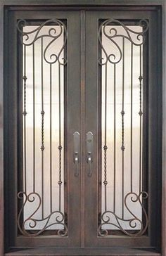 Elegant hand forged iron grilles on iron double door.